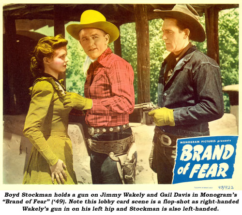 "Boyd Stockman holds a gun on Jimmy Wakely and Gail Davis in Monogram's ""Brand of Fear"" ('49). Note this lobby card scene is a flop-shot as right-handed Wakely's gun in on his left hip and Stockman is also left-handed."
