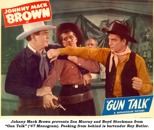 "Johnny Mack Brown prevents Zon Murray and Boyd Stockman from ""Gun Talk"" ('47 Monogram). Peaking from behind is bartender Roy Butler."