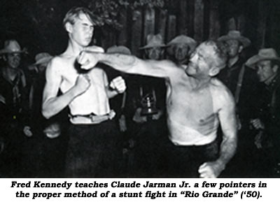 "Fred kennedy teaches Claude Jarman Jr. a few pointers in the proper method of a stunt fight in ""Rio Grande"" ('50)."