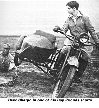 Dave Sharpe on motorcycle in one of his Boy Friends shorts.