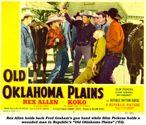 "Rex Allen holds back Fred Graham's gun hand while Slim Pickens holds a wounded man in Republic's ""Old Oklahoma Plains"" ('52)."