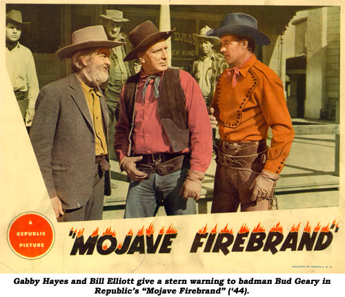 "Gabby Hayes and Bill Elliott give a stern warning to badman Bud Geary in Republic's ""Mojave Firebrand"" ('44)."