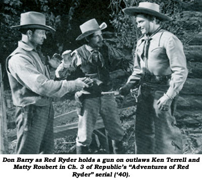 "Don Barry as Red Ryder holds a gun on outlaws Ken Terrell and Matty Roubert in Ch. 3 of Republic's ""Adventures of Red Ryder"" serial (/40)."