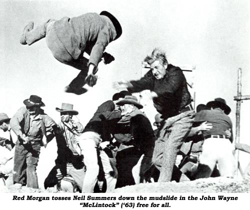 "Red Morgan tosses Neil Summers down the mudslide in the John Wayne ""McLintock"" ('63) free for all."