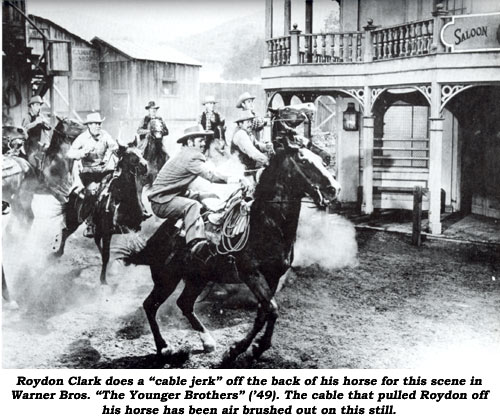 "Roydon Clark does a ""cable jerk"" off the back of his horse for this scene in Warner Bros. ""The Younger Brothers"" ('49). The cable that pulled Roydon off his horse has been air brushed out on this still."