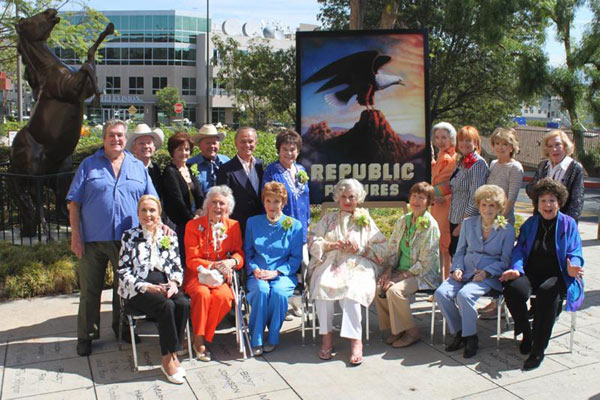 A group of 17 Republic alumni gathered on August 18, 2010, to unveil the Republic 75th Anniversary sign at CBS Studio Center (the old Republic lot on Radford Ave. in Studio City). Front row seated (L to R): Anne Jeffreys, Ann Rutherford, Joan Leslie, Adrian Booth, Coleen Gray, Shirley Mitchell, Jane Withers. Back row standing (L to R): Hugh O'Brian, Ben Cooper, Majorie Lord, Dick Jones, Tommy Cook, Donna Martell, Marsha Hunt, Eilene Janssen, Anna Maria Alberghetti, Jane Kean.