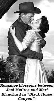 "Romance blossoms between Joel McCrea and Mari Blanchard in ""Black Horse Canyon""."