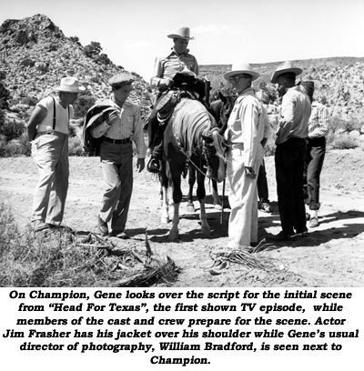 "On Champion, Gene looks over the script for the initial scene from ""Head For Texas"", the first shown TV episode, while members of the cast and crew prepare for the scene. Actor Jim Frasher has his jacket over his shoulder while Gene's usual director of photography, William Bradford, is seen next to Champion."