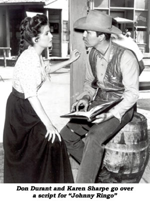 "Don Durant and Karen Sharpe go over a script for ""Johnny Ringo"""