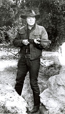 Robert Horton with rifle.