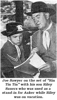 "Joe Sawyer on the set of ""Rin Tin Tin"" with his son Riley Sauers who was used as a stand-in for Aaker while Riley wa son vacation."