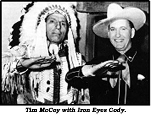 Iron Eyes Cody and Tim McCoy perform Indian sign language.