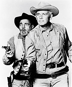 "Frank McGrath as Charlie Wooster and Terry Wilson as Bill Hawks on ""Wagon Train""."