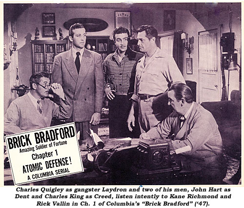 "Charles Quigley as gangster Laydron and two of his men, John Hart as Dent and Charles King as Creed, listen intently to Kane Richmond and Rick Vallin in Ch. 1 of Columbia's ""Brick Bradford"" ('47)."