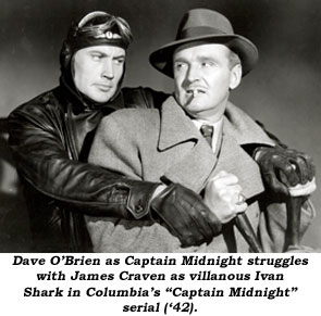 "Dave O'Brien as Captain Midnight struggles with James Craven as villianous Ivan Shark in Columbia's ""Captain Midnight"" serial ('42)."