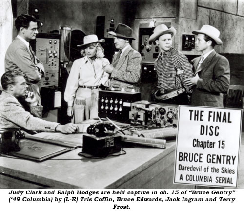 "Judy Clark and Ralph Hodges are held captive in Ch. 15 of ""Bruce Gentry"" ('49 Columbia) by (L-R) Tris Coffin, Bruce Edwards, Jack Ingram and Terry Frost."