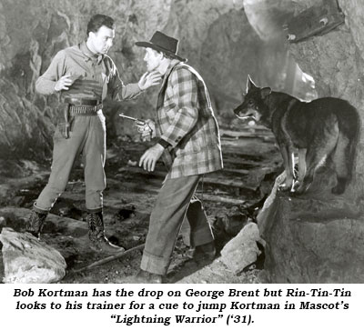 "Bob Kortman has the drop on George Brent but Rin-Tin-Tin looks to his trainer for a cue to jump Kortman in Mascot's ""Lightning Warrior"" ('31)."