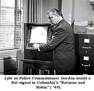 "Lyle as Police Commissioner Gordon sends a Bat-signal in Columbia's ""Batman and Robin"" ( '49)."