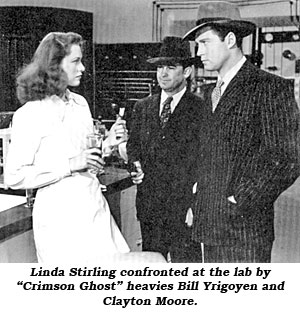 "Linda Stirling confronted at the lab by ""Crimson Ghost"" heavies Bill Yrigoyen and Clayton Moore."