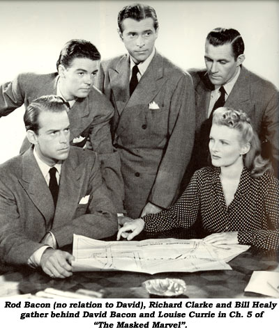 "Rod Bacon (no relation to David), Richard Clarke and Bill Healy gather behind David Bacon and Louise Currie in Ch. 5 of ""The Masked Marvel""."