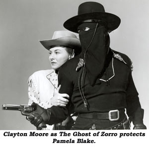 Clayton Moore as The Ghost of Zorro protects Pamela Blake.