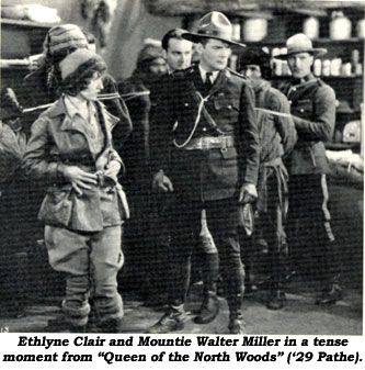"Ethlyne Clair and Mountie Walter Miller in a tense moment from ""Queen of the North Woods"" ('29 Pathe)."
