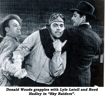 "Donald Woods grapples with Lyle Latell and Reed Hadley in ""Sky Raiders""."