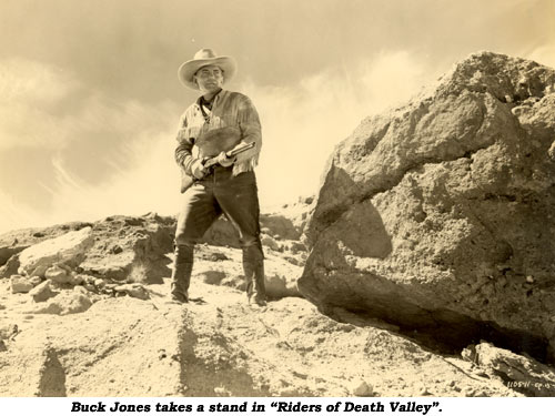 "Buck Jones takes a stand in ""Riders of Death Valley""."