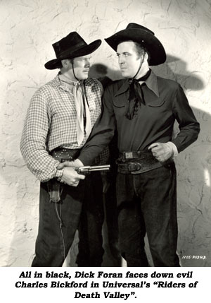 "All in black, Dick Foran faces down evil Charles Bickford in Universal's ""Riders of Death Valley""."