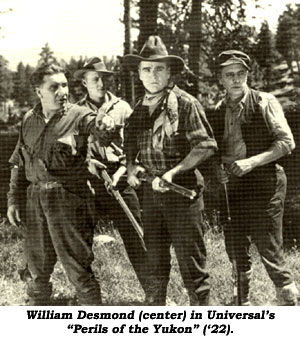 "William Desmond (center) in Universal's ""Perils of the Yukon"" ('22)."