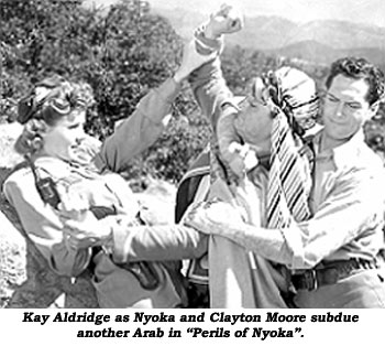 "Kay Aldridge as Nyoka and Clayton Moore subdue another Arab in ""Perils of Nyoka""."
