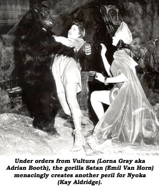 Under orders from Vultura (Lorna Gray aka Adrian Booth), the gorilla Satan (Emil Van Horn) menacingly creates another peril for Nyoka (Kay Aldridge).