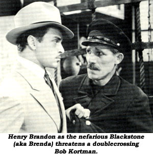 Henry Brandon as the nefarious Blackstone threatens a doublecrossing Bob Kortman.
