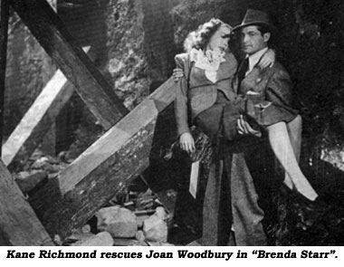 "Kane Richmond rescues Joan Woodbury in ""Brenda Starr""."