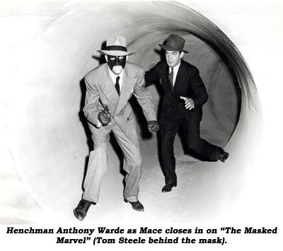 "Henchman Anthony Warde as Mace closes in on ""The Masked Marvel"" (Tom Steele behind the mask)."
