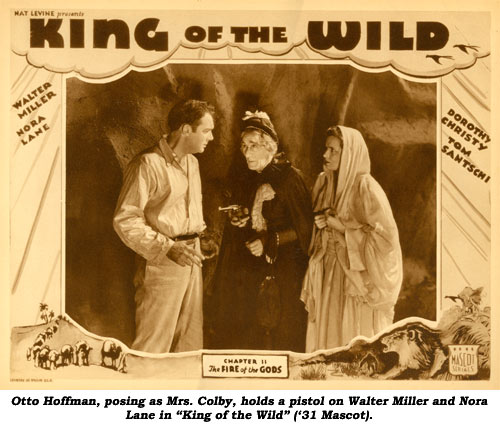 "Otto Hoffman, posing as Mrs. Colby, holds a pistol on Walter Miller and Nora Lane in ""King of the Wild"" ('31 Mascot)."
