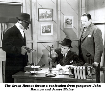 The Green Hornet forces a confession from gangsters John and James Blaine.