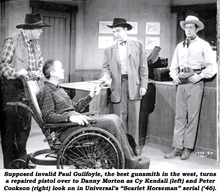 "Supposed invalid Paul Guilfoyle, the best gunsmith in the west, turns a repaired pistol over to Danny Morton as Cy Kendall (left) and Peter Cookson (right) look on in Universal's ""Scarlet Horseman"" serial ('46)."