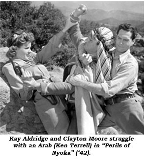 "Kay Aldridge and Clayton Moore struggle with an Arab in ""Perils of Nyoka"" ('42)."