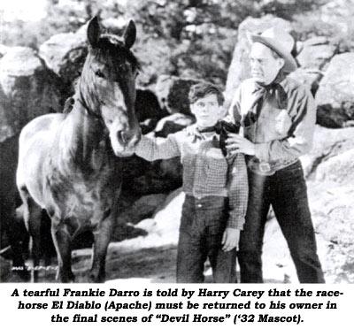 "A tearful Frankie Darro is told by Harry Carey that the racehorse El Diablo (Apache) must be returned to his owner in the final scenes of ""Devil Horse"" ('32 Mascot)."