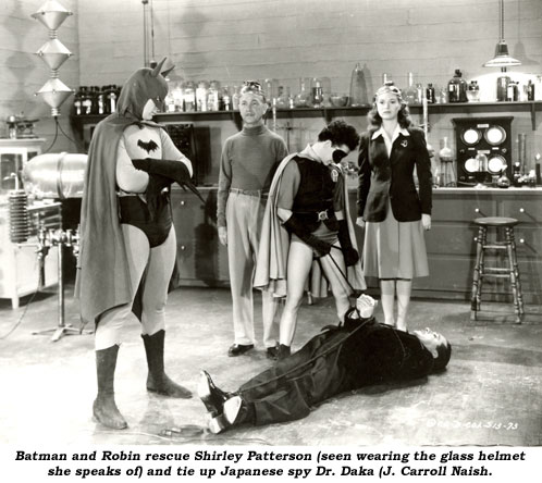 Batman and Robin rescue Shirley Patterson (seen wearing the glass helmet she speaks of) and tie up Japanese spy Dr. Daka (J. Carroll Naish).