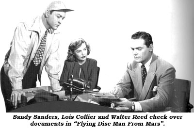 "Sandy Sanders, Lois Collier and Walter Reed check over documents in ""Flying Disc Man From Mars""."