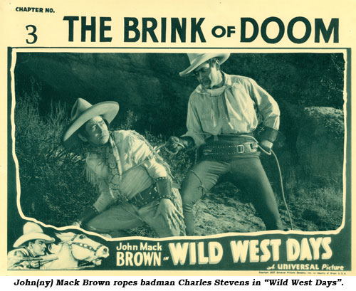 "John(ny) Mack Brown ropes badman Charles Stevens in ""Wild West Days""."