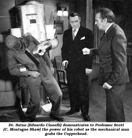 Dr. Satan (Eduardo Cianelli) demonstrates to Professor Scott (C. Montague Shaw) the power of his robot as the mechanical man grabs the Copperhead.