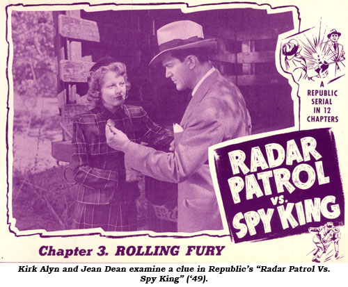 "Kirk Alyn and Jean Dean examine a clue in Republic's ""Radar Patrol Vs. Spy King"" ('49)."