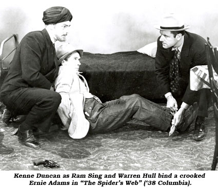 "Kenne Duncan as Ram Sing and Warren Hull bind a crooked Ernie Adams in ""The Spider's Web"" ('38 Columbia)."