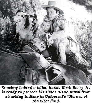 "Kneeling behind a fallen horse, Noah Beery Jr. is ready to protect his sister Diane Duval from attacking Indians in Universal's ""Heroes of the West"" ('32)."