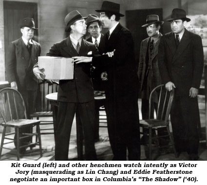 "Kit Guard (left) and other henchmen watch intently as Victor Jory (masquerating as Lin Chang) and Eddie Featherstone negotiate an important box in Columbia's ""The Shadow"" ('40)."