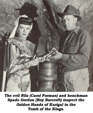 The evil Nila (Carol Forman) and henchman Spade Gordon (Roy Barcroft) inspect the Golden Hands of Kurigal in the Tomb of the Kings.