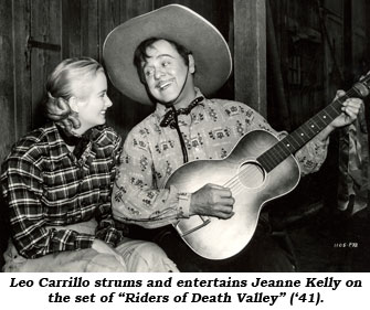 "Leo Carrillo strums his guitar and entertains Jeanne Kelly on the set of ""Riders of Death Valley"" ('41)."